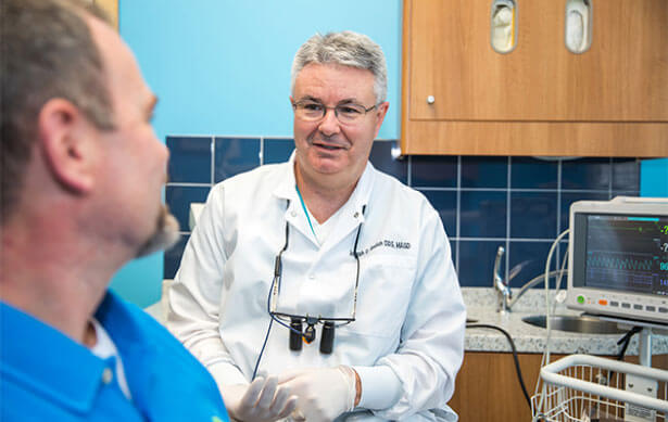Dr. Bedich talks to dental patient