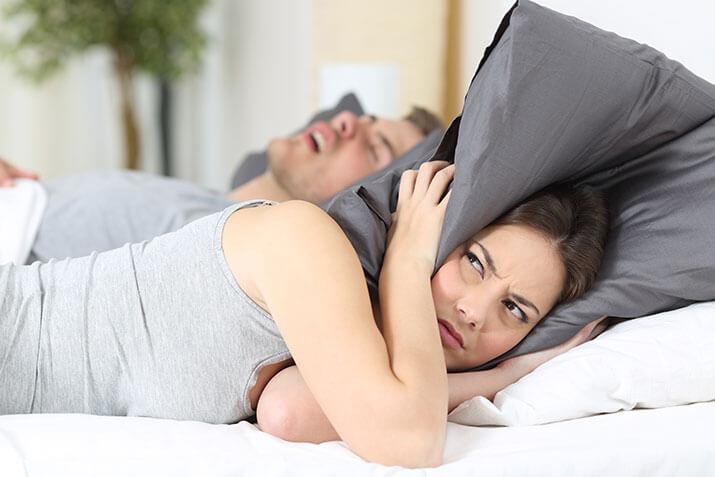 husband snoring, wife annoyed